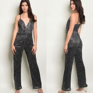 Pants - NWT $98 Silver Deep Plunge Jumpsuit fashion nova